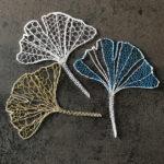 Trois feuilles de ginkgo en dentelle aux fuseaux